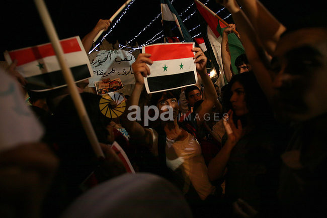 Dozens of Palestinians from Jerusalem protest in front of the Damascus Gate against the repression and massacres perpetrated by the Syrian regime against the Palestinian and Syrian people living in Syria, Jerusalem, on 18th August 2011. Photo by Muammar Awad