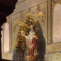 Statue of St Ferdinand III of Castile holding a sword and globe inside a mocarabe niche, in the Capilla Real or Royal Chapel, originally built under Alfonso X in the 13th century, and then rebuilt in the 14th century (completed 1371) under Enrique II in Mudejar style, in the Cathedral-Great Mosque of Cordoba, in Cordoba, Andalusia, Southern Spain. The first church built here by the Visigoths in the 7th century was split in half by the Moors, becoming half church, half mosque. In 784, the Great Mosque of Cordoba was begun in its place and developed over 200 years, but in 1236 it was converted into a catholic church, with a Renaissance cathedral nave built in the 16th century. The historic centre of Cordoba is listed as a UNESCO World Heritage Site. Picture by Manuel Cohen