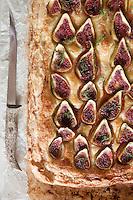 Slices of fresh fig cover this freshly baked ricotta, almond and honey tart