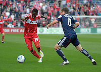 Chicago forward Patrick Nyarko (14) dribbles away from New England defender Chris Tierney (8).  The Chicago Fire defeated the New England Revolution 3-2 at Toyota Park in Bridgeview, IL on Sept. 25, 2011.