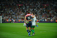 London, England - Thursday, August 9, 2012: The USA defeated Japan 2-1 to win the London 2012 Olympic gold medal at Wembley Stadium. Abby Wambach and Hope Solo walk off the field. .