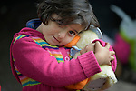 Six-year old Miriam, a refugee from Afghanistan, holds her stuffed toy duck inside a refugee processing center in the Serbian village of Presevo, not far from the Macedonian border. Hundreds of thousands of refugees and migrants--including many children--have flowed through Serbia in 2015, on their way from Syria, Iraq and other countries to western Europe. <br /> <br /> Parental consent obtained.