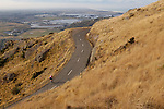Cyclist on twisty road on the Banks Peninsula, Christchurch, New Zealand