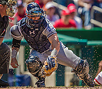 27 April 2014: San Diego Padres catcher Yasmani Grandal in action against the Washington Nationals at Nationals Park in Washington, DC. The Padres defeated the Nationals 4-2 to to split their 4-game series. Mandatory Credit: Ed Wolfstein Photo *** RAW (NEF) Image File Available ***