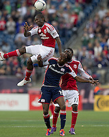 Portland Timbers midfielder Diego Chara (21) gets some height and heads the ball as New England Revolution midfielder Clyde Simms (19) defends. In a Major League Soccer (MLS) match, the New England Revolution defeated Portland Timbers, 1-0, at Gillette Stadium on March 24, 2012