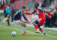 02 April 2011: Chivas USA defender/midfielder Jorge Flores #19 and Toronto FC midfielder Tony Tchani #22 in action during an MLS game between Chivas USA and the Toronto FC at BMO Field in Toronto, Ontario Canada..The game ended in a 1-1 draw.