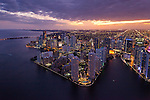 Aerial view of Brickell Key in Downtown Miami at twilight.