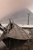 Satellite dish snapped by weight of volcanic ash from eruption of Sinabung Volcano, Sumatra, Indonesia