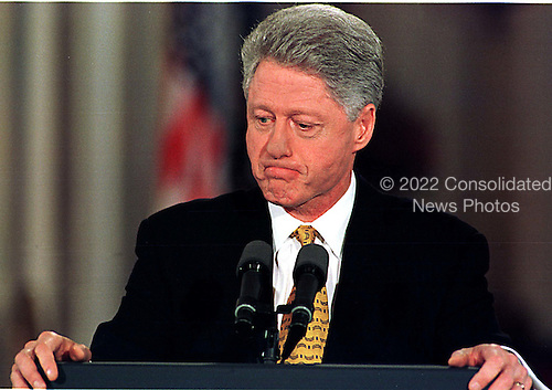Washington, DC - March 19, 1999 -- United States President Bill Clinton contemplates a question during his press confrence on March 19, 1999..Credit: Ron Sachs / CNP