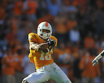 Tennessee defensive back Janzen Jackson (15) intercepts a pass intended for Ole Miss wide receiver Melvin Harris (5) in a college football game at Neyland Stadium in Knoxville, Tenn. on Saturday, November 13, 2010. Tennessee won 52-14.