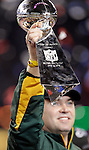Green Bay Packers coach Mike McCarthy holding the Vince Lombardi Trophy after Packers beat the Steelers in Super Bowl XLV..The Green Bay Packers played the Pittsburgh Steelers in Super Bowl XLV,  Sunday February 6, 2011 in Cowboys Stadium. Steve Apps-State Journal.