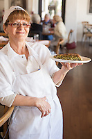 Olga holds a plate of Spanikopita and Olga at Kipos in Chapel Hill, N.C. on Thursday, March 13, 2014. (Justin Cook)