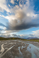 Broad landscape of the East Fork of the Toklat river, a braided river in Denali National Park, Alaska.