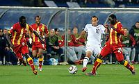 Landon Donovan of USA takes on Kwadwo Asahmoah, Andre Ayew and Hans Sarpei of Ghana. USA vs Ghana in the 2010 FIFA World Cup at Royal Bafokeng Stadium in Rustenburg, South Africa on June 26, 2010.