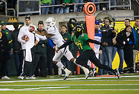 October 6th, 2011:  Marvin Jones of California tries to catch the ball but was dropped during a game against Oregon Ducks at Autzen Stadium in Eugene, Oregon - Oregon defeated Cal 43 - 15