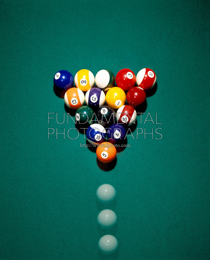 TRANSFER OF ENERGY - BILLIARD BALL BREAK <br /> Before Cue Ball Strikes Rack<br /> Cue ball strikes target ball &amp; transfers all its energy to forward momentum of target ball and into pool ball rack. An ordered system of low entropy (the racked balls) is changed to disorder and higher entropy.