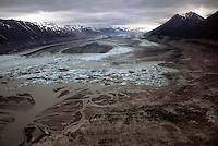 Lowell Glacier spills into Lowell Lake and the Alsek River in Kluane National Park, Yukon Territory, Canada.<br /> <br /> Lowell Glacier is approximately 70 km long and averages 5 km wide. The glacier terminates at 600 m elevation in Lowell Lake, about 60 km southwest of Haines Junction, Yukon. The Alsek River flows into Lowell Lake from the north and exits the south end of the lake.