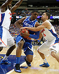 Terrence Jones, under pressure from Florida players, during the championship game of the 2011 SEC Men's Basketball Tournament, played at the Georgia Dome, on Sunday, March 13, 2011.  Jones finished with 16 points.  Photo by Latara Appleby | Staff