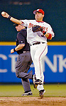 12 June 2006: Jose Vidro, second baseman for the Washington Nationals, makes a turn-around play to first against the Colorado Rockies at RFK Stadium, in Washington, DC. The Nationals fell to the Rockies 4-3 in the first game of the four game series...Mandatory Photo Credit: Ed Wolfstein Photo..