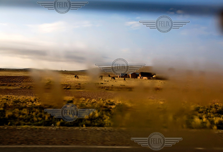 Moisture on the window of a car as it travels through the Bolivian countryside.