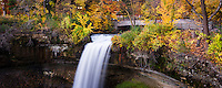 Minnehaha Falls surrounded by autumn colors.