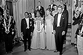United States President John F. Kennedy and First Lady Jacqueline Kennedy stand in front of the Grand Staircase of the White House in Washington, DC prior to a dinner in honor of President of the Ivory Coast, F&eacute;lix Houphou&euml;t-Boigny, and First Lady of the Ivory Coast, Marie-Th&eacute;r&egrave;se Houphou&euml;t-Boigny on May 22, 1962. Front row (L-R): President Houphou&euml;t-Boigny; Mrs. Houphou&euml;t-Boigny; Mrs. Kennedy; President Kennedy. Others (L-R): Ambassador of the Ivory Coast, Henri Konan B&eacute;di&eacute;; U.S. Ambassador to the Ivory Coast, R. Borden Reams; Military Aide to President Kennedy, General Chester V. Clifton; Air Force Aide to President Kennedy, Brigadier General Godfrey T. McHugh; Virginia Rusk; U.S. Secretary of State Dean Rusk (mostly hidden); Naval Aide to President Kennedy, Captain Tazewell Shepard. <br /> Credit: Arnie Sachs / CNP