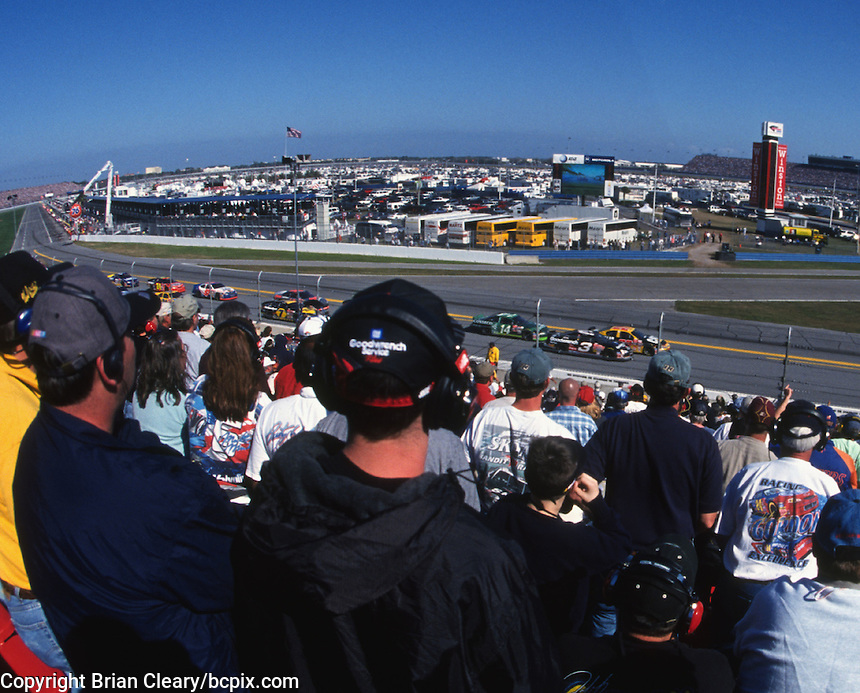Fans watch Dale Eaernhardt and Ward Burton battle for the lead during the 2001 Daytona 500. (Photo by Brian Cleary/www.bcpix.com)