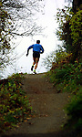 December 9,  2002 - Dan Browne is a U.S. champion marathon runner who lives in the Nike house in Northwest Portland. He runs up a trail up to Terwilliger Blvd on which he runs sprints up and down. Also, he and sleeps in a high-altitude controlled environment to help with the production of red blood cells.