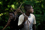 Simon Peter Gamana (right) and Charles Gorden patrol the forest near their village of Riimenze, in Southern Sudan's Western Equatoria State, on the look out for the Lord's Resistance Army, which has displaced tens of thousands in recent months along the border area. Many believe the northern Sudan government is behind the attacks in its desire to destabilize the south in the period leading to a January 2011 referendum on secession.