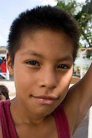 A boy hangs out at the docks. Jose Besteni's Tuna fishing Company K&O in Tuxpan. Veracruz, Mexico. June 18, 2007