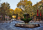 The Cours Mirabeau in Aix-en-Provence, Provence, France, viewed at dawn looking toward the Rotonde from the Nine Cannons Fountain (Fontaine des Neuf Canons).