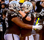 Oakland Raiders guard Gabe Jackson (66) and quarterback Derek Carr (4) celebrate touchdown on Saturday, December 24, 2016, at O.co Coliseum in Oakland, California.  The Raiders defeated the Colts 33-25.