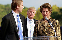Oct. 04, 2011 - Charlottesville, VA. USA; Donald Trump will oversee Trump Vineyard Estates and Winery run by his son Eric trump, left, and  former owner Patricia Kluge, right. A press conference was held to announce the grand opening of Trump Vineyard Estates Tuesday in Charlottesville, Va. Trump purchased the foreclosed vineyard, previously owner by Patricia Kluge, at auction earlier this year. The 2,000 acre Trump Vineyard estate is also the home to Trump Winery, helmed by Donald's son Eric Trump.  (Credit Image: © Andrew Shurtleff)