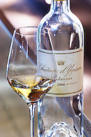 glass and bottle of 2004 chateau d'yquem sauternes bordeaux france