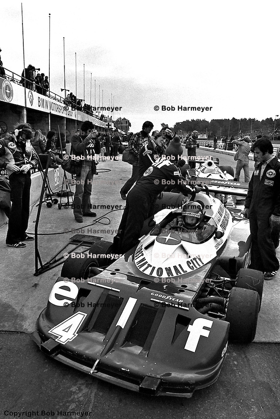 WATKINS GLEN, NY: Patrick Depailler waits to drive the  Tyrrell P34 7/Ford Cosworth DFV during a practice session for the United States Grand Prix East on October 2, 1977, at the Watkins Glen Grand Prix Race Course near Watkins Glen, New York.