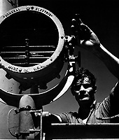 On board the USS SANDLANCE on war patrol.  R.H. Swickard (QM2/c) operating searchlight.  May 1945.  (Navy)<br /> Exact Date Shot Unknown<br /> NARA FILE #:  080-G-468151<br /> WAR &amp; CONFLICT BOOK #:  936