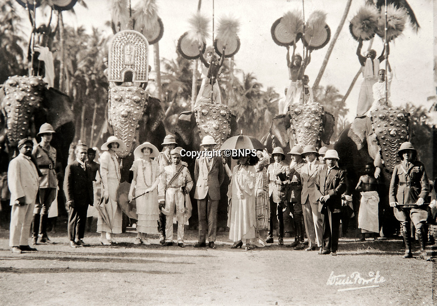 BNPS.co.uk (01202 558833)<br /> Pic: PhilYeomans/BNPS<br /> <br /> On parade - Lord and Lady Goschen (centre) with various local dignitaries and four magnificent ceremonial elephants.<br /> <br /> Last Days of the Raj - A fascinating family album from one of the last Viceroy's of India reveal Britain's 'Jewel in the Crown' in all its splendour.<br /> <br /> The family album of Viscount George Goschen has been unearthed after 90 years, and provide's an amazing snapshot of the pomp and pageantry of a wealthy and powerful British family in India in the 1920s and 30's.<br /> <br /> They show the Governor of Madras and his family enjoying a lavish lifestyle of parades, banquets and hunting and horse racing in the last decades of the Raj.<br /> <br /> At the time, Gandhi was organising peasants, farmers and labourers to protest against excessive land-tax and discrimination. <br /> <br /> The album consists of some 300 large photographs. They have remained in the family for 90 years but have now emerged for auction following a house clearance and are tipped to sell for &pound;200.