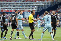 Referee Baldomero Toldeo explains to Kansas City midfielder Graham Zusi what the call is, much to Zusi's disbelief... Sporting Kansas City defeated San Jose Earthquakes 2-1 at LIVESTRONG Sporting Park, Kansas City, Kansas.
