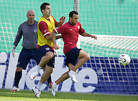 USA's Landon Donovan, right, is guarded by teamate Carlos Bocenegra while Marcus Hahnemann defends the goal during practice in Hamburg, Germany, for the 2006 World Cup, June, 9, 2006.