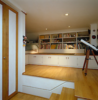 A series of built-in cupboards provides this child's bedroom with plenty of storage options
