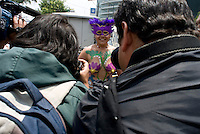Media frenzy for the only topless woman to participate. Mexico City, on Saturday, June 9, 2007. An estimated 100 people participated in this protest designed to force cardrivers to be more concietious of vulnerable bike riders.