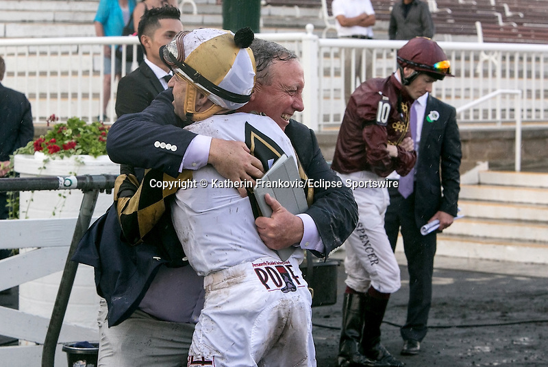 August 15, 2015. Jockey Joe Bravo celebrates with the connections of Watsdachances with jockey Jamie Spencer after being placed 1st in the G1 Secretariat Stakes. Jockey Jamie Spencer who rode Secret Gesture was disqualified and placed 3rd. Katherin Frankovic/ESW/CSM