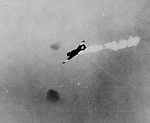 May 8, 1942 - A Japanese torpedo plane is hit during fighting in the Battle of the Coral Sea.