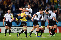 Ionut Botezatu and the rest of the Romania team celebrate at the final whistle. Rugby World Cup Pool D match between Canada and Romania on October 6, 2015 at Leicester City Stadium in Leicester, England. Photo by: Patrick Khachfe / Onside Images