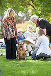 Pastor David Bonde blesses a pet owner during a special Blessing of the Animals service in honor of St. Francis at the Los Altos Lutheran Church.