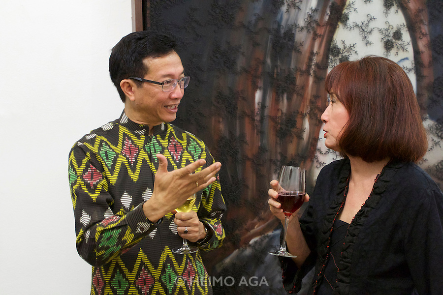 "Vienna, Austria. Galerie Suppan Contemporary. Vernissage of Zico Albaiquni (Indonesia), ""beyond the veil"". H.E. Rachmat Budiman, Indonesian Ambassador to Austria, speaking with Dr. Melani Setiawan."