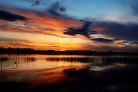 Low angle view of sunset over the River Shannon, near the The Monastery of Clonmacnoise, County Offaly, Ireland. Picture by Manuel Cohen