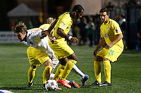 New York Cosmos player Mads Stokkelien (L ) is fouled by Tampa Bay Rowdies players during their soccer match in the North American Soccer League in New York. Eduardo MunozAlvarez/VIEWpress 04/18/2015