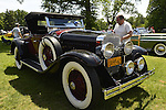 Old Westbury, New York, U.S. - June 1, 2014 -  A red and black 1927 La Salle 303 Roadster, owner JOHN MICCICHE of SMITHTOWN, is an entry at the Antique and Collectible Auto Show held on the historic grounds of elegant Old Westbury Gardens in Long Island, and sponsored by Greater New York Region AACA Antique Automobile Club of America.