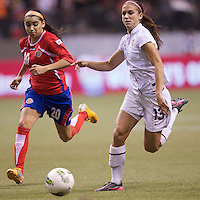 Wendy Acosta, left, of Costa Rica and Alex Morgan of the United States chase down a ball during play in the CONCACAF Olympic Qualifying semifinal match at BC Place in Vancouver, B.C., Canada Friday Jan. 27, 2012. The United States won the match 3-0 to earn a berth in 2012 London Olympics.
